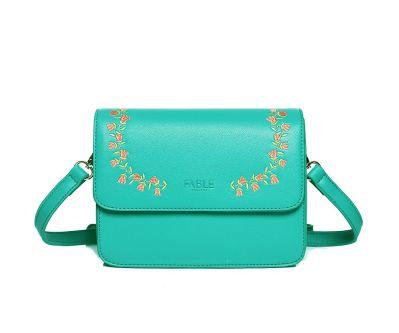 turquoise green handbag